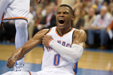 Nov 18, 2015; Oklahoma City, OK, USA; Oklahoma City Thunder guard Russell Westbrook (0) reacts after being fouled on a made shot against the New Orleans Pelicans during the fourth quarter at Chesapeake Energy Arena. Mandatory Credit: Mark D. Smith-USA TODAY Sports